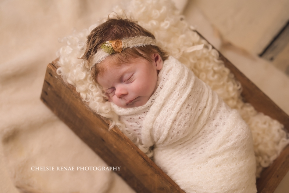 Ginger Newborn wrapped in cream