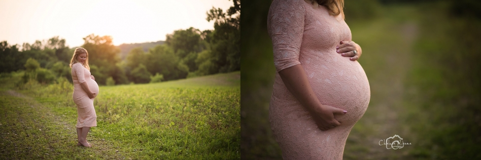 pink maternity dress during the golden light in a field