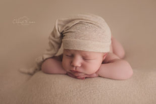 Tan sleepy hat newborn sleeping photograph