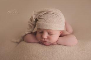 Tan sleepy hat newborn sleeping photograph