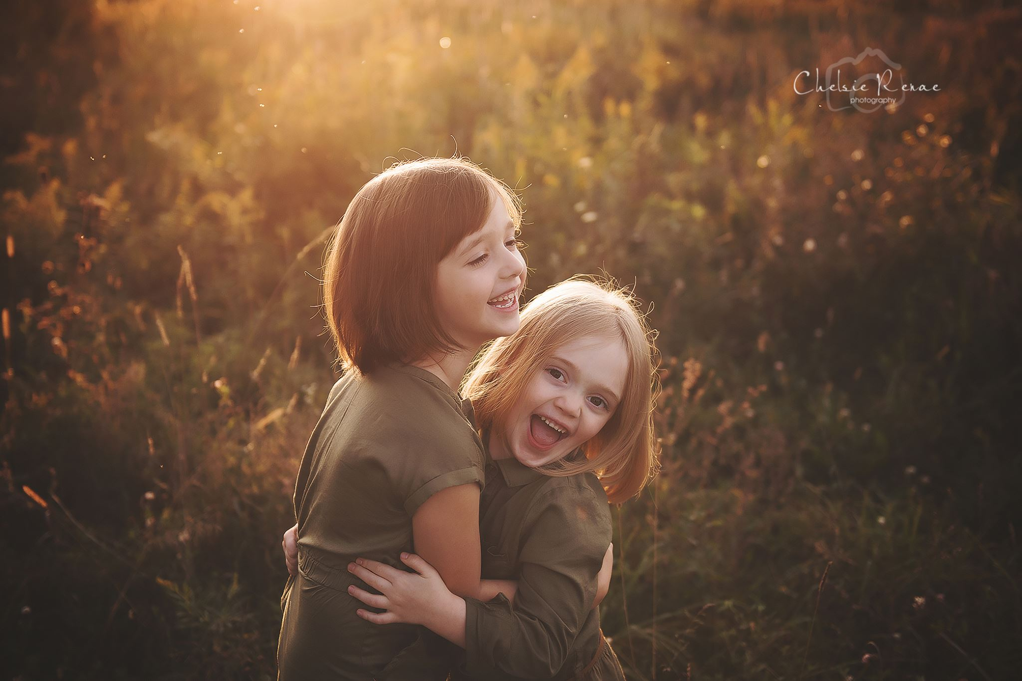 sister hugging in beatiful golden light